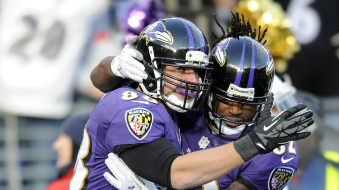Baltimore Ravens tight end Dennis Pitta (88) and wide receiver Torrey Smith (82) celebrate Pitta's touchdown during the second half of an NFL wild card playoff football game against the Indianapolis Colts Sunday, Jan. 6, 2013, in Baltimore. (AP Photo/Nick Wass)