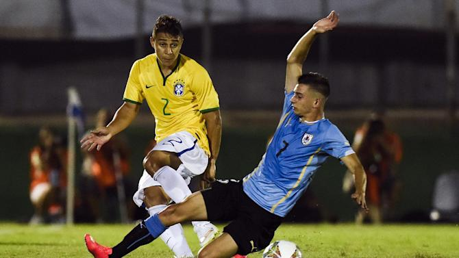 Uruguay's Facundo Castro, right, fights for the ball with Brazil's Joao Pedro during their South America Under-20 soccer match in Montevideo, Uruguay, Monday, Jan. 26, 2015