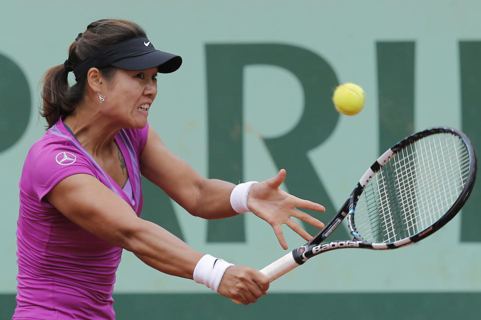 Li Na of China returns in her fourth round match against Yaroslava Shvedova of Kazakhstan at the French Open tennis tournament in Roland Garros stadium in Paris, Monday June 4, 2012. (AP Photo/Michel Euler)
