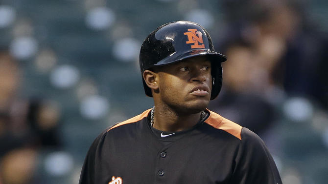 The Netherlands' Dashenko Ricardo (21) reacts after striking out against the Dominican Republic's Edinson Volquez during the third inning of a semifinal game of the World Baseball Classic in San Francisco, Monday, March 18, 2013. (AP Photo/Eric Risberg)