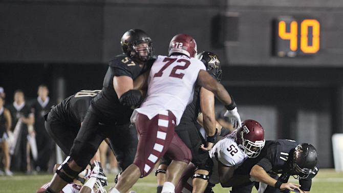 Vanderbilt quarterback Stephen Rivers (17) fumbles the ball on a sack by Temple's Avery Ellis (52) during the second quarter of an NCAA college football game Thursday, Aug. 28, 2014, in Nashville, Tenn. The fumble was returned for a touchdown by Temple's Averee Robinson, not seen