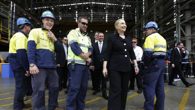 "FILE - In this Nov. 15, 2012, file photo, U.S. Secretary of State Hillary Rodham Clinton, second from right in front, meets with shipbuilders at the Techport Australia shipbuilding facility near Adelaide, Australia. As secretary of state, Clinton called the Trans-Pacific Partnership the ""gold standard"" in efforts to create open and fair trade during this 2012 trip, but now as a presidential candidate, she's struck a far more cautious tone on that emerging agreement: non-committal with a strong hint of skepticism.  (AP Photo/Matt Rourke, Pool, File)"