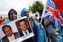 A Somali woman holds images of Britain's Prime Minister David Cameron and Somali President Hassan Sheikh Mohamud in Mogadishu, on May 7, 2013