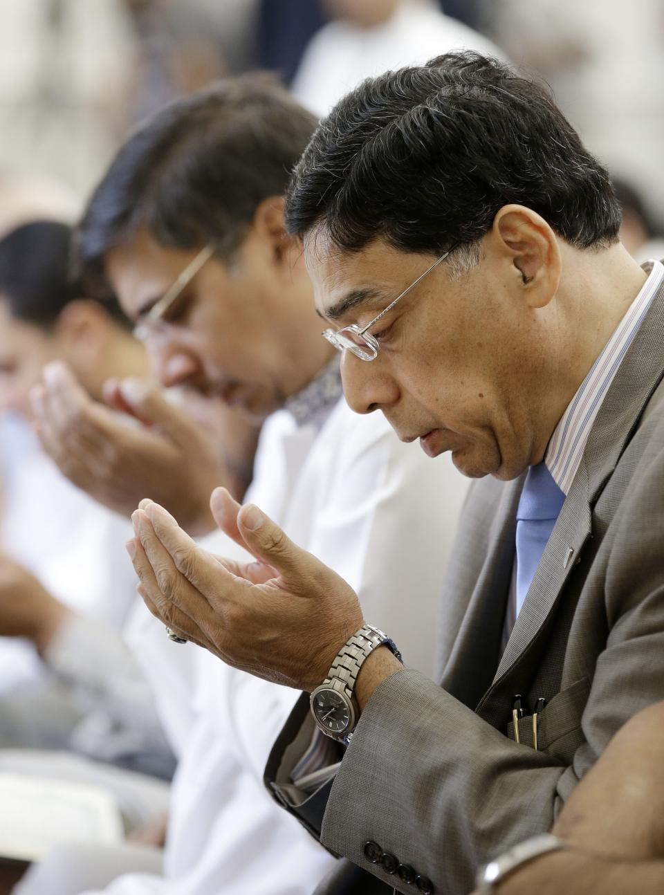 Wasim Qureshi, right, and his brother, Nadeem Qureshi, left, attend midday prayers at the Islamic Center of Murfreesboro on Friday, Aug. 10, 2012, in Murfreesboro, Tenn. Opponents of  the mosque waged a two-year court battle trying to keep it from opening. (AP Photo/Mark Humphrey)