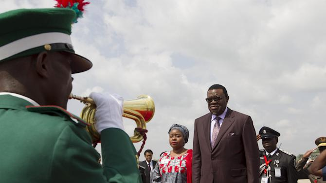 Namibia's President Hage Geingob receives guard of honour upon arrival at the airport in Abuja