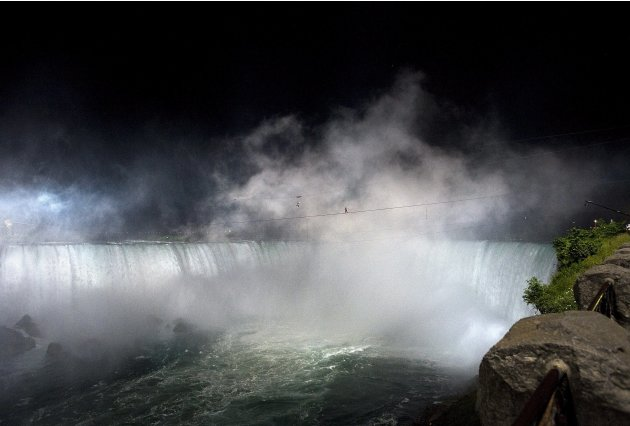 Nik Wallenda nears the middle of his tightrope walk over Niagara Falls as seen from Niagara Falls, Ontario, on Friday, June 15, 2012. Wallenda has finished his attempt to become the first person to wa