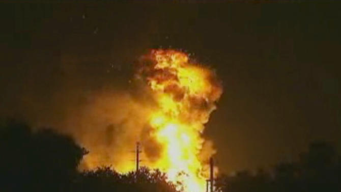 In this image taken from Associated Press video, flames rise from an explosion at the Blue Rhino propane plant in Tavares City, Fla., late Monday, July 29, 2013. John Herrell of the Lake County Sheriff's Office said early Tuesday that there were no fatalities despite massive blasts that ripped through the gas plant. Seven people were injured and transported to local hospitals. (AP Photo/AP video)