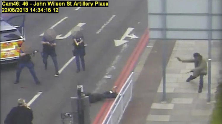 Adebolajo and Adebolawe are intercepted by armed police, in Woolwich on May 22, 2013, in this still image taken from CCTV footage