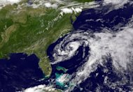 This image obtained from NASA's GOES Project, shows Tropical Storm Beryl (C) as it sits off the US coast on May 26. Beryl was upgraded to a tropical storm as it plowed toward the coast of the southeastern United States, casting a shadow over the first big beach weekend of the US summer season