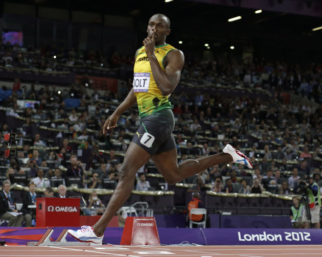 FILE - In this Thursday, Aug. 9, 2012 file photo, Jamaica's Usain Bolt gestures as he crosses the finish line to win gold in the men's 200-meter final during the athletics in the Olympic Stadium at th