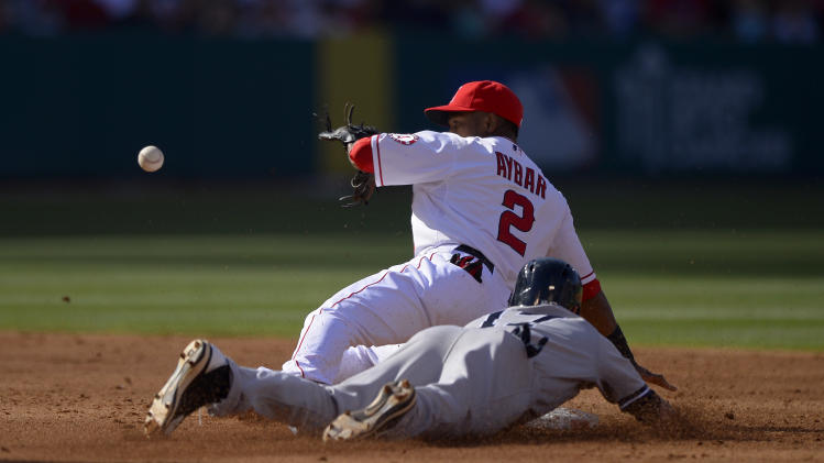 New York Yankees' Jayson Nix, bottom, steals second as Los Angeles Angels shortstop Erick Aybar takes a late throw during the third inning of their baseball game onSaturday, June 15, 2013, in Anaheim, Calif. (AP Photo/Mark J. Terrill)