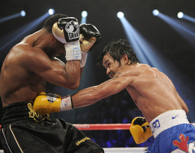 Manny Pacquiao, right, lands a blow to the body against Shane Mosley in the eighth round during a WBO welterweight title bout, Saturday, May 7, 2011, in Las Vegas.  (AP Photo/Mark Terrill)