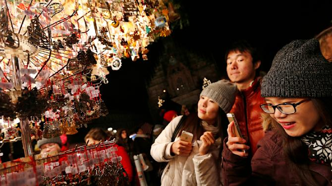 Tourists take pictures of Christmas decorations at opening day of Germany's oldest Christkindlesmarkt in Nuremberg