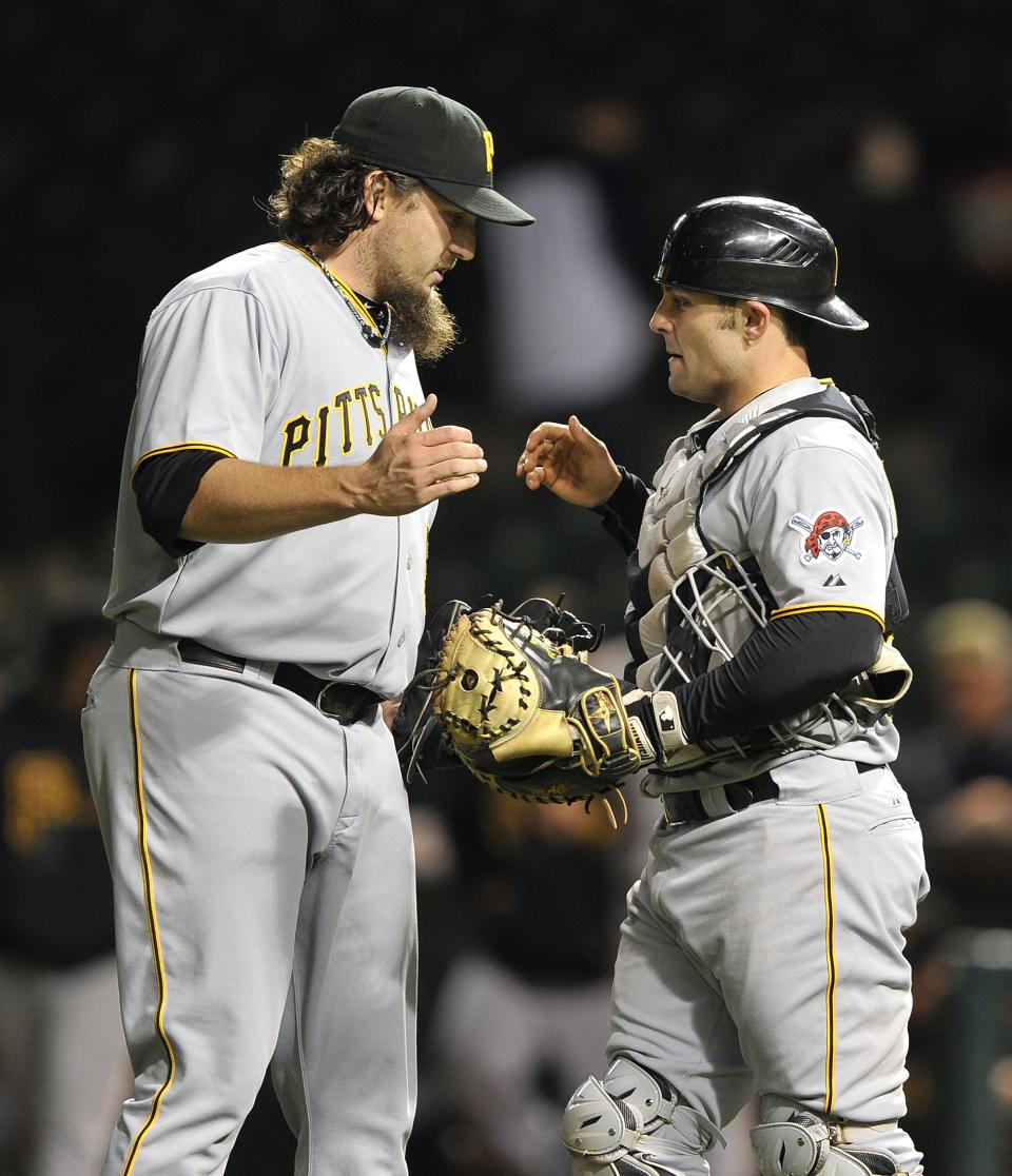 Pittsburgh Pirates' Joel Hanrahan left, is congratulated by Michael McKenry after the Pittsburgh Pirates defeated then Chicago Cubs 3-0 in a baseball game Tuesday, Sept. 18, 2012, in Chicago. (AP Photo/Jim Prisching)