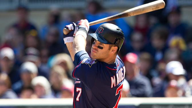 May 12, 2013; Minneapolis, MN, USA; Minnesota Twins designated hitter Joe Mauer (7) hits a double during the sixth inning against the Baltimore Orioles at Target Field. (Brace Hemmelgarn-USA TODAY Sports)