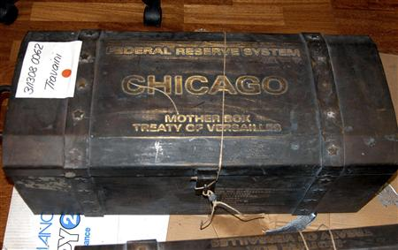 A trunk containing fake U.S. Treasury bonds is displayed during a news conference in the southern Italian city of Potenza