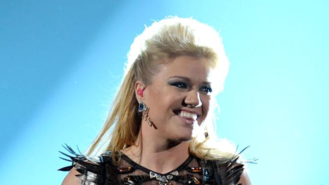 FILE - In this Nov. 18, 2012 file photo, Kelly Clarkson performs a medley of her songs at the 40th Annual American Music Awards, in Los Angeles.  Clarkson and fun. are just two of the acts who will perform during the upcoming inaugural festivities, which also includes Beyonce, James Taylor, Stevie Wonder, Katy Perry and dozens of others. (Photo by John Shearer/Invision/AP, File)