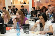 Visitors participate in a wine tasting at the London International Wine Fair, where the Decanter World Wine Award winners were announced