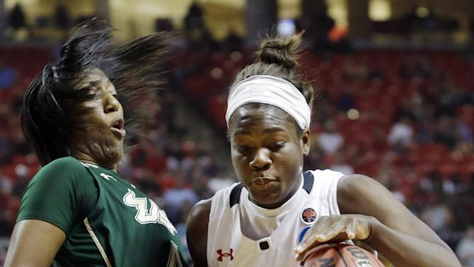 South Florida forward Tiffany Conner, left, takes the charging foul against Texas Tech guard Christine Hyde (5) during the second half of a first-round game in the women's NCAA college basketball tournament in Lubbock, Texas, Saturday, March 23, 2013. South Florida won 71-70. (AP Photo/LM Otero)