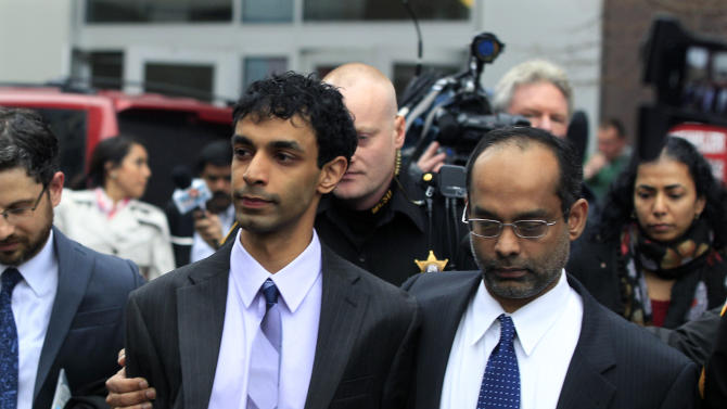Dharun Ravi, center, is hugged by his father, Ravi Pazhani, right, as they leave court around noon in New Brunswick, N.J., Friday, March 16, 2012.  Ravi, a former Rutgers University student accused of using a webcam to spy on his gay roommate's love life has been convicted of bias intimidation and invasion of privacy. A jury found that he used a webcam to spy on roommate Tyler Clementi.  (AP Photo/Mel Evans)