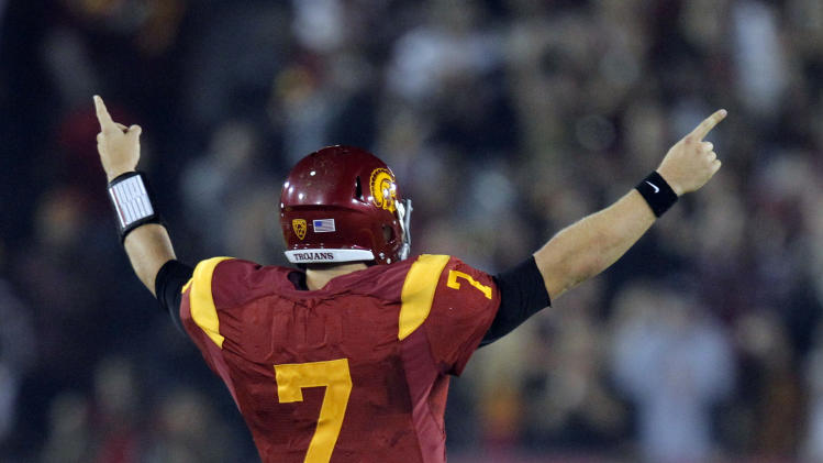 FILE - In this Nov. 26, 2011 file photo, Southern California quarterback Matt Barkley reacts during an NCAA college football game against UCLA in Los Angeles. USC is ranked No. 1 in the Associated Press preseason college football poll released on Saturday, Aug. 18, 2012. (AP Photo/Jae Hong, File)