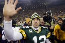 Green Bay Packers quarterback Aaron Rodgers waves to fans after defeating the Minnesota Vikings in their NFL NFC wildcard playoff football game in Green Bay