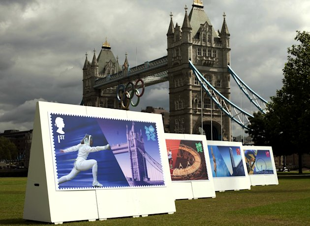 Enlarged images of Royal Mail's Welcome to the London 2012 Olympics stamps are displayed at Potters Fields, London on Monday July 23, 2012. The postal service says it will issue a stamp honoring every member of Team GB who wins a gold medal during the games. It is promising to have them on sale within 24 hours of the athlete's victory. (AP Photo/David Parry, PA) UNITED KINGDOM OUT; NO SALES; NO ARCHIVE