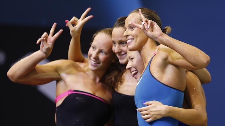 Team Italy celebrates after winning the women's 4x200m freestyle final at the European Swimming Championships in Berlin