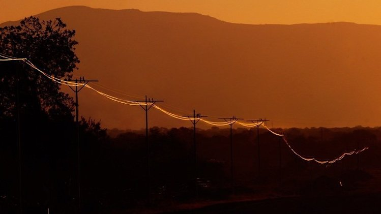 Electricity wires pictured at sunset in Mokopane, 60kms southwest of Polokwane, South Africa, on June 21, 2010