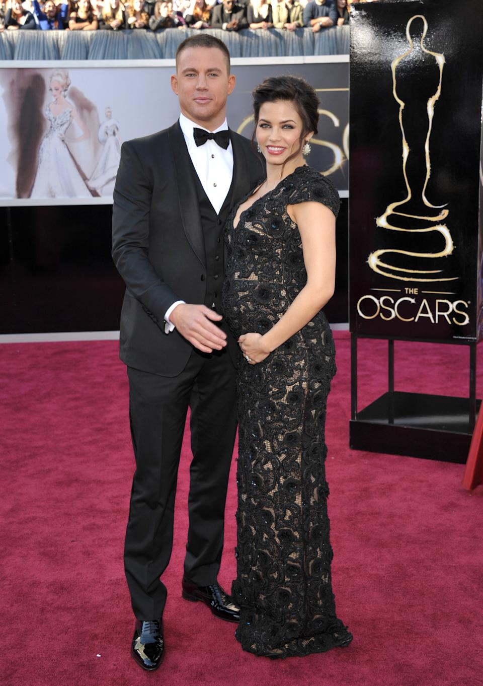 FILE - This Feb. 24, 2013 file photo shows actors Channing Tatum and his pregnant wife Jenna Dewan-Tatum at the 85th Academy Awards at the Dolby Theatre in Los Angeles.  Fashion experts say a streamlined style best suits a baby bump.  (Photo by John Shearer/Invision/AP)