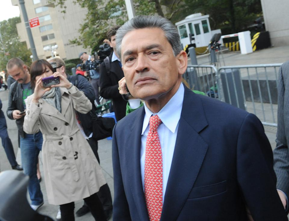 In this Oct. 26, 2011 photo, Rajat Gupta exits Manhattan federal court in New York following arraignment. The insider trading trial of the former board member for Goldman Sachs and Procter & Gamble begins in New York on Monday, May 21, 2012, with jury selection. (AP Photo/ Louis Lanzano)