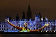 An image of Jamaica's track star Usain Bolt, currently the world's fastest man, is projected on The Houses of Parliament in London, on July 27, during the opening ceremony of the London 2012 Olympic Games