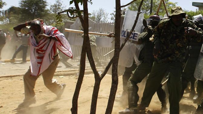 Riot policemen disperse residents during protests to oust the Narok county Governor Samuel Tunai in Narok, Kenya
