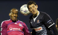 Lyon's Jimmy Briand, left, is challenged by Dinamo Zagreb's Arijan Ademi during the Champions League group D soccer match between Dinamo Zagreb and Lyon, in Zagreb, Croatia, Wednesday, Dec. 7, 2011. (AP Photo/Darko Bandic)