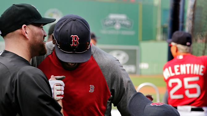 Chicago White Sox third baseman Kevin Youkilis, left, whispers in the ear of his former teammate Boston Red Sox designated hitter David Ortiz during batting practice before a baseball game at Fenway Park in Boston, Monday, July 16, 2012. Youkilis returned to Fenway, where he was a member of the 2004 and 2007 World Series Champion teams, for the first time since being traded. At rear right is Red Sox manager Bobby Valentine, his former manager. (AP Photo/Charles Krupa)