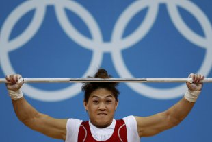 Kazakhstan's Maiya Maneza competes on the women's 63Kg weightlifting competition at the ExCel venue at the London 2012 Olympic Games July 31, 2012. (R...