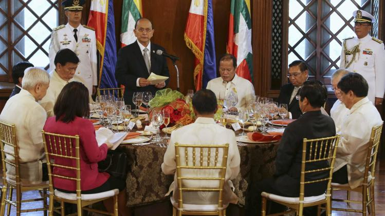 Myanmar's President Thein Sein delivers speech beside Philippine President Aquino at State Luncheon during visit in Manila