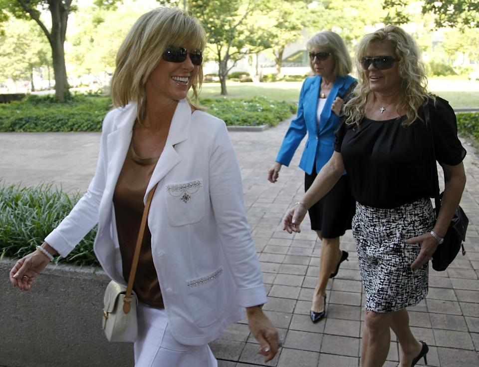 Debbie Clemens, wife of former Major League Baseball pitcher Roger Clemens, left, arrives at federal court in Washington, Monday, June 11, 2012. (AP Photo/Haraz N. Ghanbari)