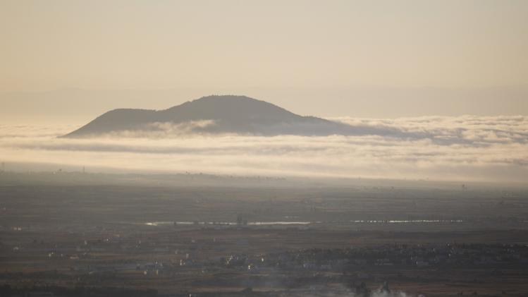 Smoke rises after an explosion on the Syrian side of the Quneitra crossing