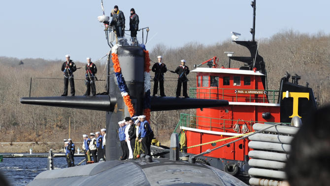 FILE - In this March 2, 2011 file photo, the Los Angeles Class attack submarine USS Memphis returns to the U.S. Navy Submarine Base in Groton, Conn., after a two-month deployment that was its final mission. When the Navy discovered a cheating ring aboard the USS Memphis, it swiftly fired the commanding officer and kicked off 10 percent of the crew. An investigation report obtained by the AP through a Freedom of Information Act request describes an atmosphere aboard the Memphis that tolerated and even encouraged cheating. (AP Photo/The Day, Sean D. Elliot, File) MANDATORY CREDIT; MAGS OUT