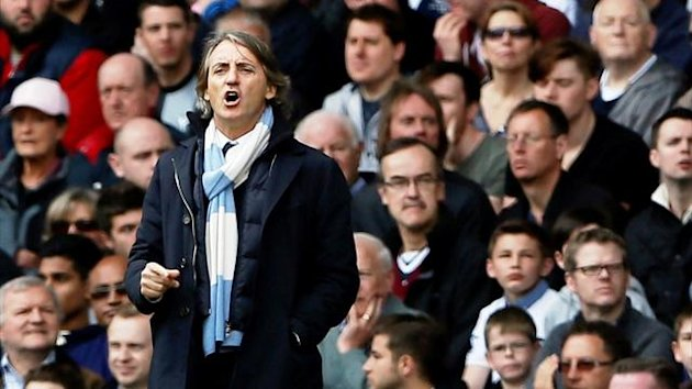 Roberto Mancini at White Hart Lane (Reuters)