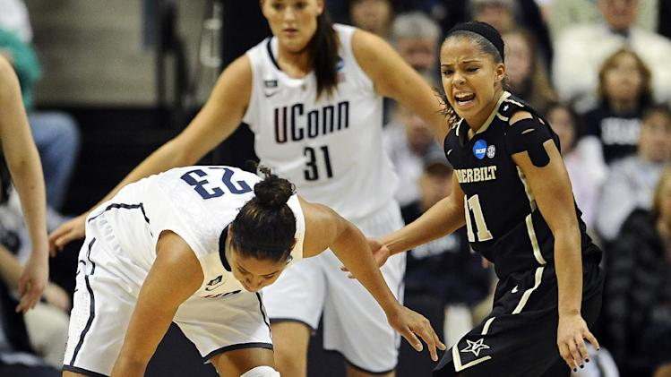 Vanderbilt's Jasmine Lister, right, reacts after Connecticut's Kaleena Mosqueda-Lewis steals the ball from her in the first half of a second-round game in the women's NCAA college basketball tournament in Storrs, Conn., Monday, March 25, 2013. (AP Photo/Jessica Hill)