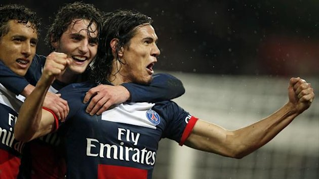 Paris Saint Germain's Edinson Cavani (R) celebrates with his team mates after he scored against FC Lorient during their French Ligue 1 soccer match at the Parc des Princes Stadium in Paris November 1, 2013 (Reuters)
