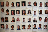 Photos of newly hired reporters are seen in the newsroom of the Orange County Register in Santa Ana, Calif., Thursday, Dec. 27, 2012. After years of demoralizing layoffs, one newspaper is trying something novel: hiring more reporters. The Orange County Register's new owner thinks the way to turn the paper around is through better reporting to lure new and former readers to a revived product. (AP Photo/Jae C. Hong)