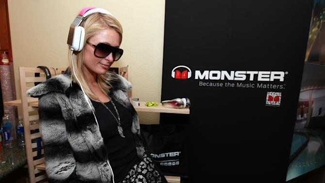Paris Hilton wears Inspiration headphones by Monster Products at the Fender Music lodge during the Sundance Film Festival on Sunday, Jan. 20, 2013, in Park City, Utah. (Photo by Barry Brecheisen/Invision for Fender/AP Images)