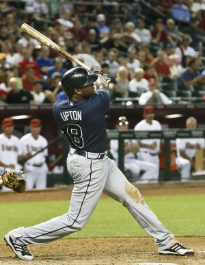 Atlanta Braves' Justin Upton connects for a two-run home run against the Arizona Diamondbacks, his former team, during the sixth inning of a baseball game, on Monday, May 13, 2013, in Phoenix. (AP Photo/Ross D. Franklin)