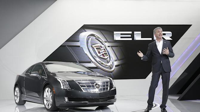 Mark Adams, Executive Director of Cadillac Global Design stands next to the Cadillac ELR after its unveiling during the North American International Auto Show in Detroit, Tuesday, Jan. 15, 2013. (AP Photo/Carlos Osorio)