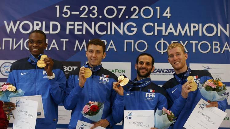 Lefort, Simon, Le Pechoux and Mertine of France's men's foil team pose with their gold medals at the World Fencing Championships in Kazan