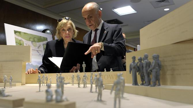 Daniel J. Feil, executive architect of the Eisenhower Memorial Commission, right, talks with Susan Banes Harris, who chairs the Commission's architecture committee, as they look over architect Frank Gehry's model of the Eisenhower Memorial before a meeting of the Eisenhower Memorial Commission on Capitol Hill in Washington, Tuesday, May 15, 2012. Designers from architect Frank Gehry's firm unveiled some changes to a planned memorial honoring President Dwight D. Eisenhower in Washington after hearing complaints from members of Eisenhower's family.(AP Photo/Susan Walsh)
