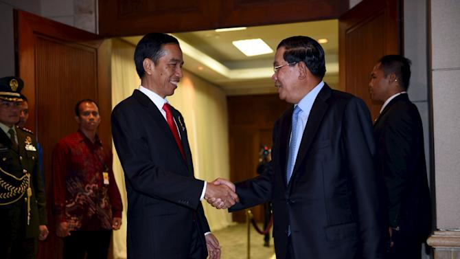 Indonesia's President Joko Widodo meets Cambodian Prime Minister Hun Sen during bilateral meeting on the sideline of Asian African Conference in Jakarta